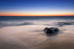 Seascape sunrise from Sandy Hook New Jersey. Clear sky sunrise at Sandy Hook Beach Stock Images