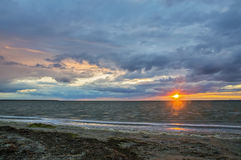Seascape, sunrise, the sun breaks through the clouds Royalty Free Stock Images