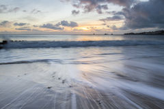 Seascape with sunrise in Swanage bay Stock Photography
