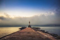 Seascape at sunset. Lighthouse on the coast. Royalty Free Stock Image