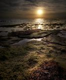 Seascape. Sunset over sea, ebb, beautiful seascape. Saturated sky Royalty Free Stock Photography
