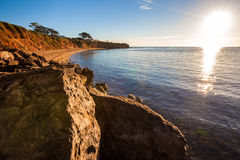 Seascape of Sunset overlooking house on a cliff Royalty Free Stock Photos