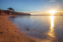 Seascape of Sunset overlooking house on a cliff Royalty Free Stock Images