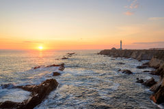 Seascape at sunset. Point Arena Lighthouse on the coast. Stock Photo