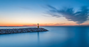 Seascape sunset with purple sky and sea. Long exposure. Rimini bay docks royalty free stock images