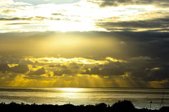 Seascape at sunset the rays. Of the sun through the clouds Royalty Free Stock Photography