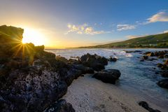 Seascape with sunstar at Pointe des Trois Bassins in la Reunion royalty free stock photography