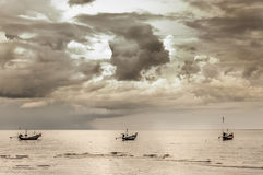 Seascape with three fishing boat within the storm cloud Stock Image