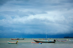 Seascape with three fishing boat within the storm cloud Royalty Free Stock Photo