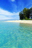 Tropical beach. Blue sky and clear water Royalty Free Stock Photo