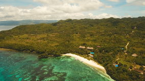 Seascape with tropical island, beach, resort, hotels. Bohol, Anda area, Philippines. stock video footage