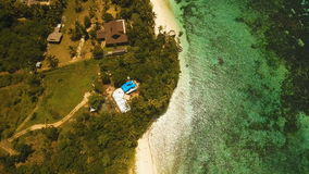 Seascape with tropical island, beach, resort, hotels. Bohol, Anda area, Philippines. Aerial view: sea and the tropical island with beach,resort, hotels stock video footage