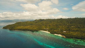 Seascape with tropical island, beach, resort, hotels. Bohol, Anda area, Philippines. Aerial view: sea and the tropical island with beach,resort, hotels stock video