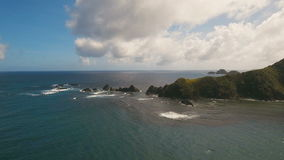 Seascape with tropical island, beach, rocks and waves. Catanduanes, Philippines. Aerial view coast of the tropical island with the mountains and the rainforest stock footage
