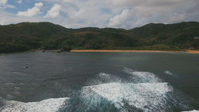 Seascape with tropical island, beach, rocks and waves. Catanduanes, Philippines. stock footage