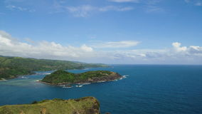 Seascape with tropical island, beach, rocks and waves. Catanduanes, Philippines. Topical island with the mountains and the rainforest on a background of ocean stock footage
