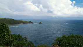 Seascape with tropical island, beach, rocks and waves. Catanduanes, Philippines. Topical island with the mountains and the rainforest on a background of ocean stock video footage