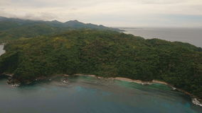 Seascape with tropical island, beach, rocks and waves. Catanduanes, Philippines. stock video footage