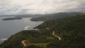 Seascape with tropical island,mountain road, beach, rocks and waves. Catanduanes, Philippines. stock video