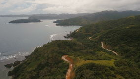 Seascape with tropical island,mountain road, beach, rocks and waves. Catanduanes, Philippines. stock footage