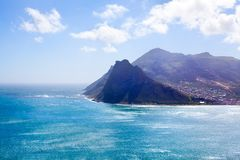 Seascape turquoise ocean water, blue sky, white clouds panorama, mountains view landscape, Cape Town, South Africa coast travel stock photo