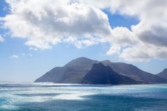 Seascape turquoise ocean water, blue sky, white clouds panorama, mountains view landscape, Cape Town, South Africa coast travel royalty free stock photography