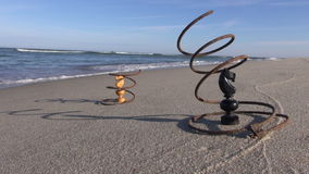 Seascape with two metal springs with two chess knight figures stock footage