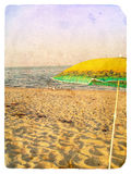 Seascape with umbrella. Old postcard. Stock Photography