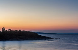 Seascape under solnedgången Arkivbild