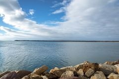 Seascape in Viana do Castelo bay in a sunny and peaceful day stock images