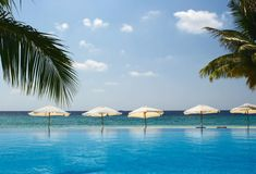Seascape view. On the Indian Ocean with beach umbrellas, Maldives Stock Image