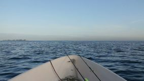 Aboard fishing boat. Seascape view from the aboard small fishing boat stock video footage