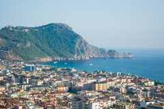 Seascape, view of the city and mountains with fortress wall Royalty Free Stock Images