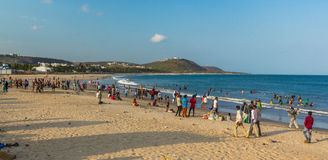 Seascape view with group of people,friends,horse riding,mountain background.Rishikonda beach,Visakhapatnam,AP,India,March 05 2017 stock photo