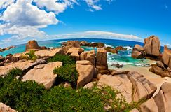Seascape view  with a huge stones. Seascape  fisheye view  with a huge stones, Seychelles, LaDigue island, The Indian Ocean Stock Images