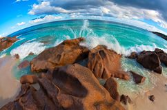 Seascape view  with a huge stones. Seascape  fisheye view  with a huge stones, Seychelles, LaDigue island, The Indian Ocean Stock Photo