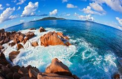 Seascape view  with a huge stones. Seascape  fisheye view  with a huge stones, Seychelles, LaDigue island, The Indian Ocean Stock Photography