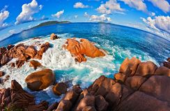 Seascape view  with a huge stones. Seascape  fisheye view  with a huge stones, Seychelles, LaDigue island, The Indian Ocean Royalty Free Stock Photography
