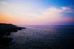 A seascape view in Malta during Sunset. A seascape view in Malta along the coast of Xaghjra during Sunset Stock Photos