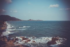 Seascape view with stones in retro style Royalty Free Stock Image
