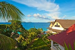 Seascape view with a tropical hotel. Perfect seascape view with a tropical hotel,  Seychelles, LaDigue island Royalty Free Stock Images