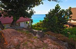 Seascape view with a tropical hotel. Perfect seascape view with a tropical hotel,  Seychelles, LaDigue island Royalty Free Stock Photo