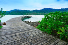 Seascape view of wood port with boat Royalty Free Stock Image