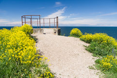 Seascape viewing platform on the edge of cliff Stock Photo
