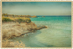 Seascape on a vintage card. Vintage card with Mediterranean seascape Stock Images