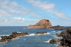 Seascape. Volcanic island near the coast. Island Madeira royalty free stock photography