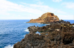 Seascape. Volcanic island near the shore. Madeira island royalty free stock image