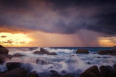 Seascape of wave and strom on rock , Long Exposure at Sunset on. The beach in Phuket Thailand Stock Image