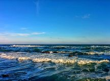 Seascape with waves and blue sky Stock Images