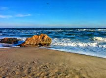Seascape with waves and coastal rocks Stock Photos